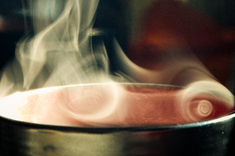 [Image description: close photograph of the vapour rising in swirls from a cup of hot liquid.]     Heather Katsoulis  / Creative Commons