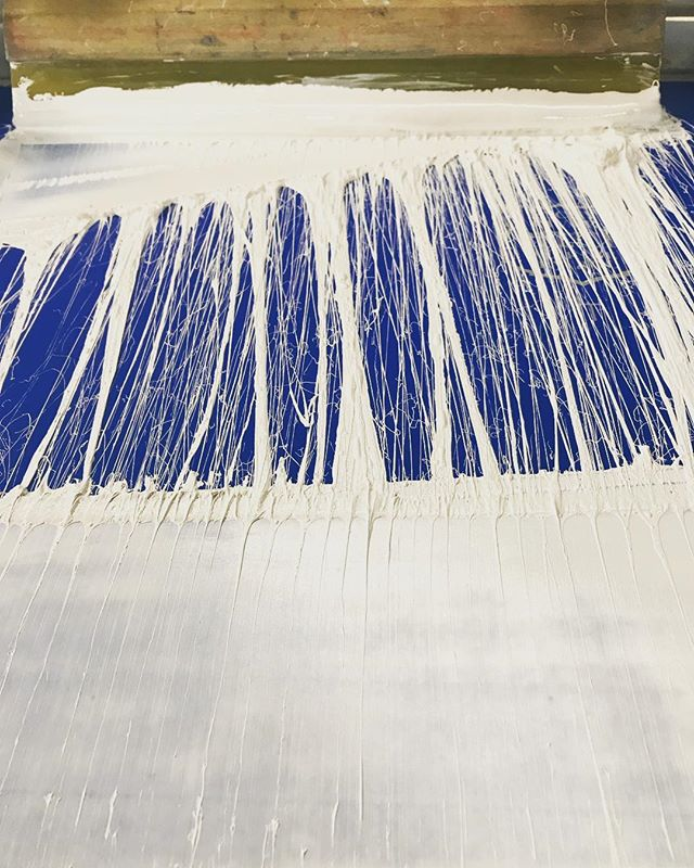 Some nice stringy poly ink makes a cool pattern in the screen #screenprinting #screenprintinglife #polyink #squeegee