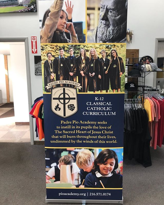 Banner stands? Yep. We can do them! Here's a really sharp looking one for our friends at Padre Pio Academy #screenprinting #bannerstands #digitalprinting #cleveland #cle