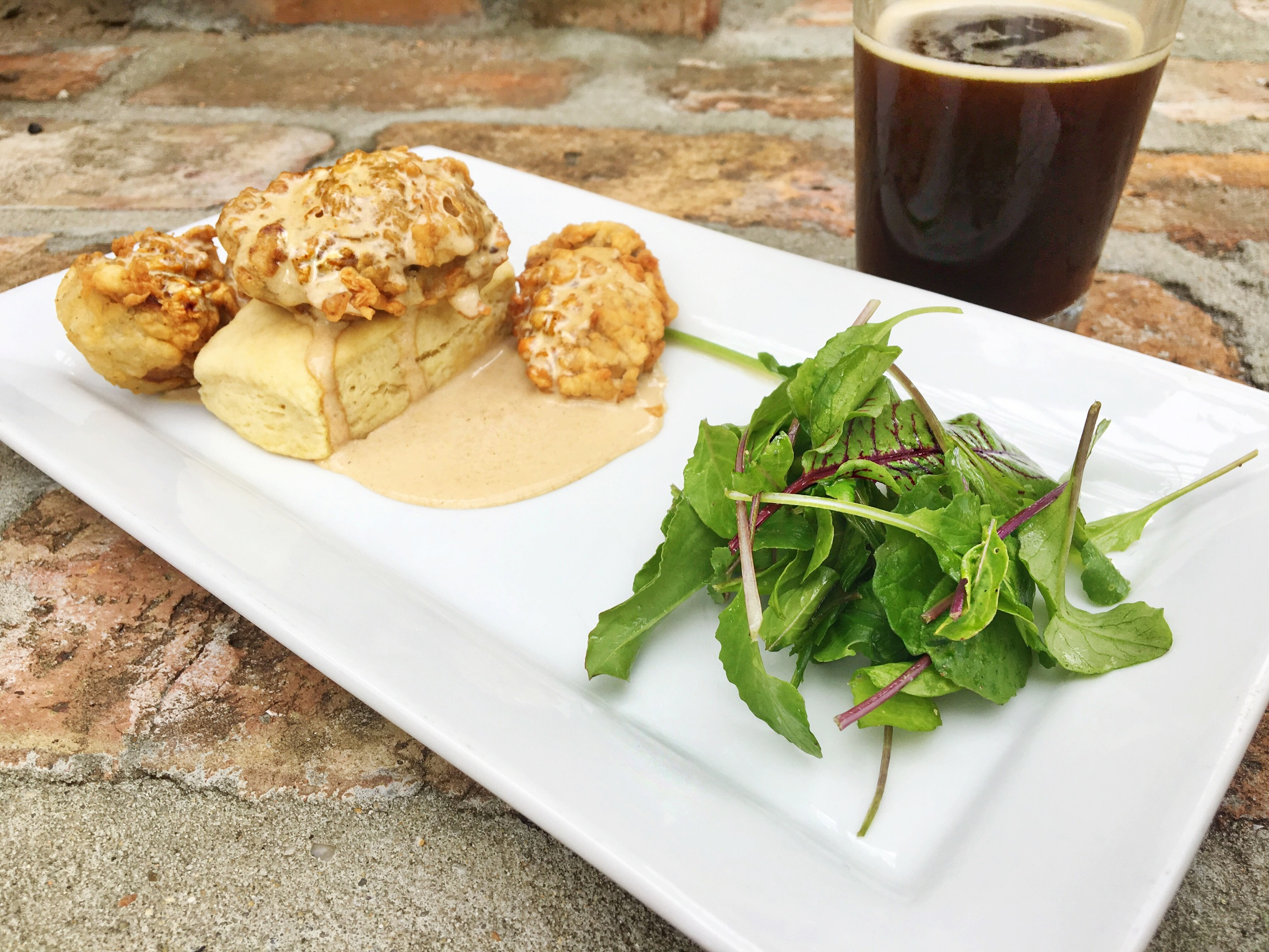Biscuit, field greens, fried oysters, red eye gravy and Biere Joi Coffee Ale