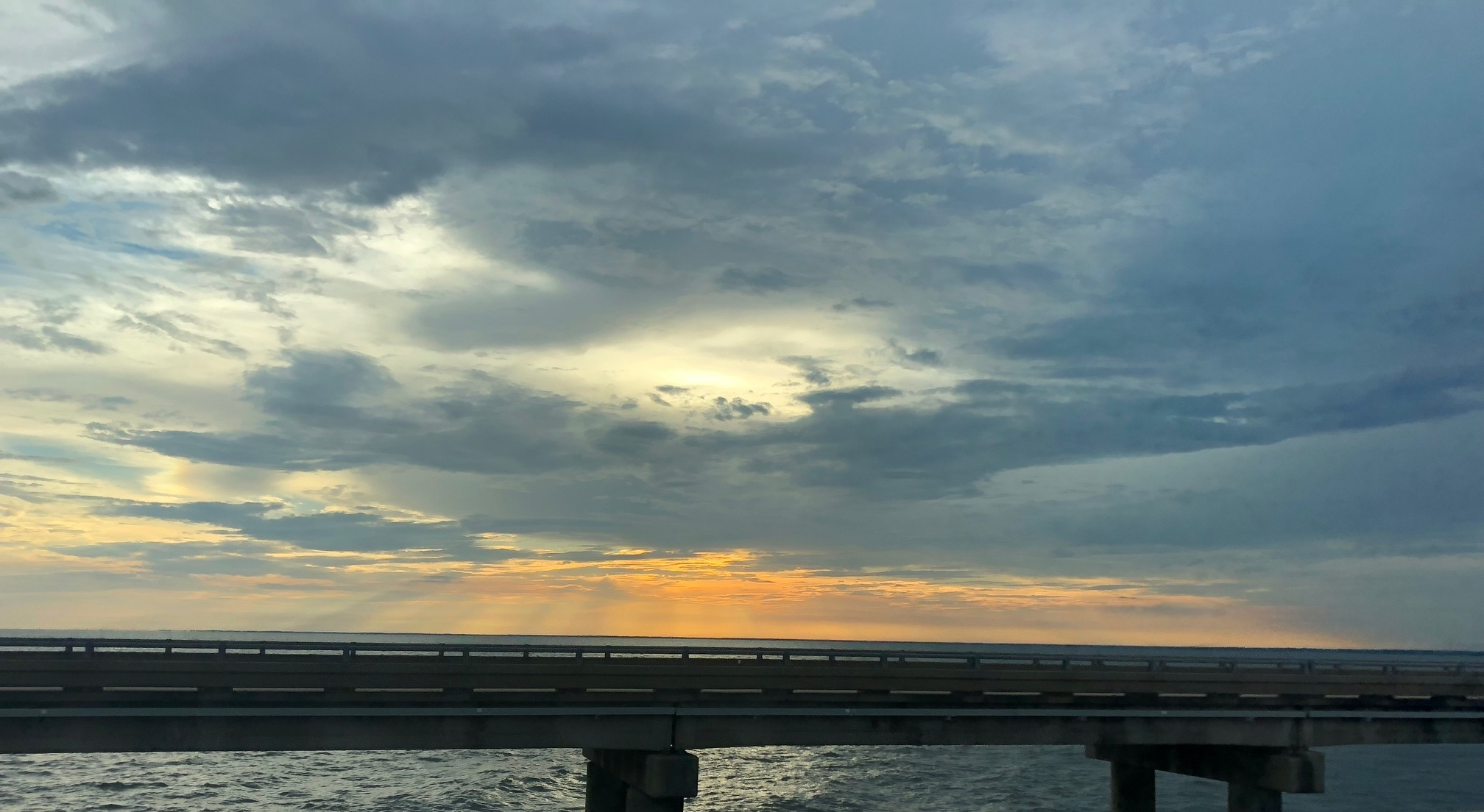 Pro tip: try not to take photos of the sunset skies while commuting on one of the longest bridges in the world.