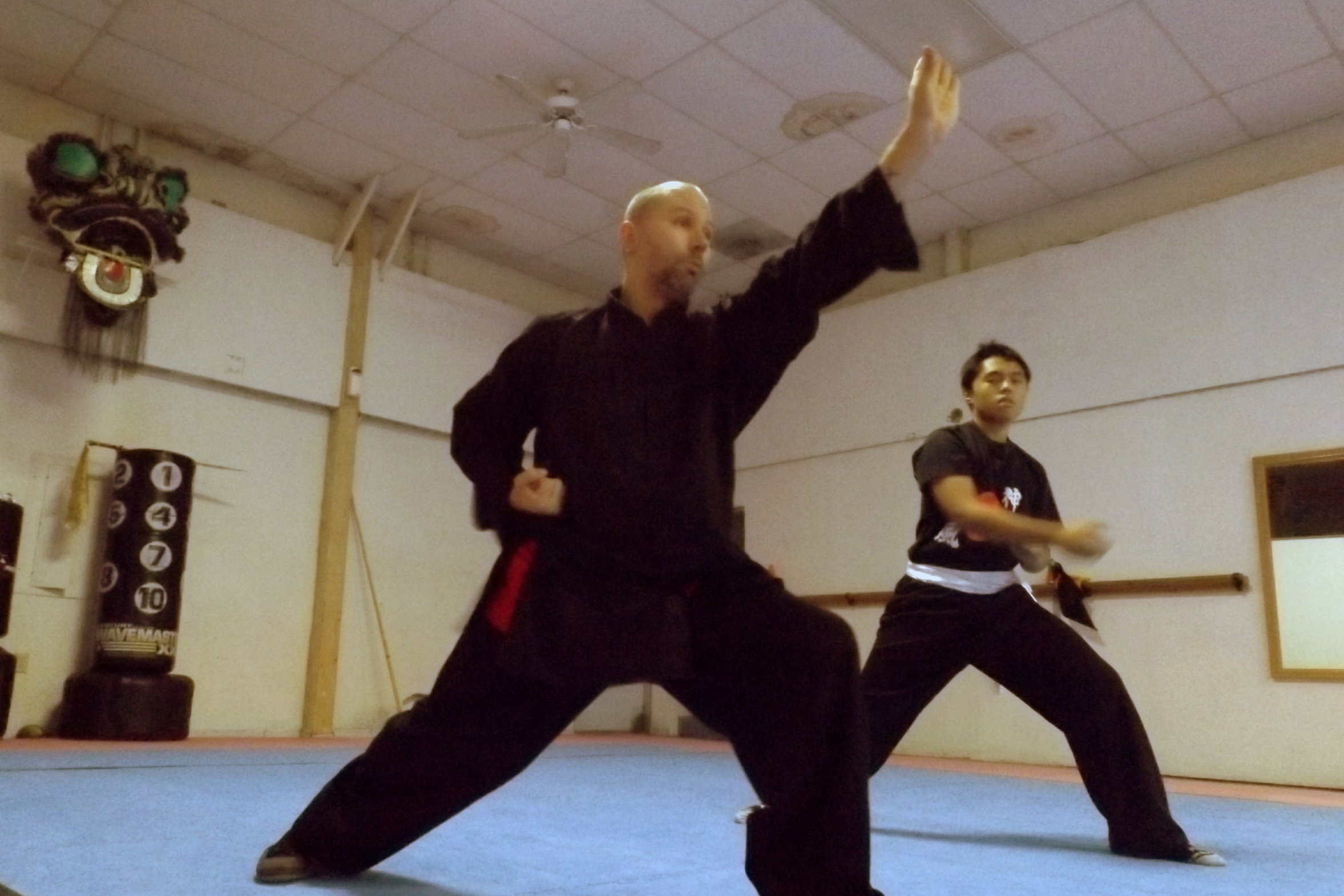 Sifu Norm has been studying traditional Kung Fu for over 18 years within the Shaolin Kung Fu system he teaches. His passion and primary focus is on traditional mind and body conditioning, stances, empty hand and weapons forms. He emphasizes the artistry of Kung Fu for the benefits it gives the practitioner, however the heart of even the most beautiful Kung Fu movement is rooted in martial application. Sifu Norm has trained under Sifu Mathers, and Sigung Eric Lee as well as others, but it was Sifu Brandon who taught him from beginner to his current second degree black sash level, and title as Sifu.