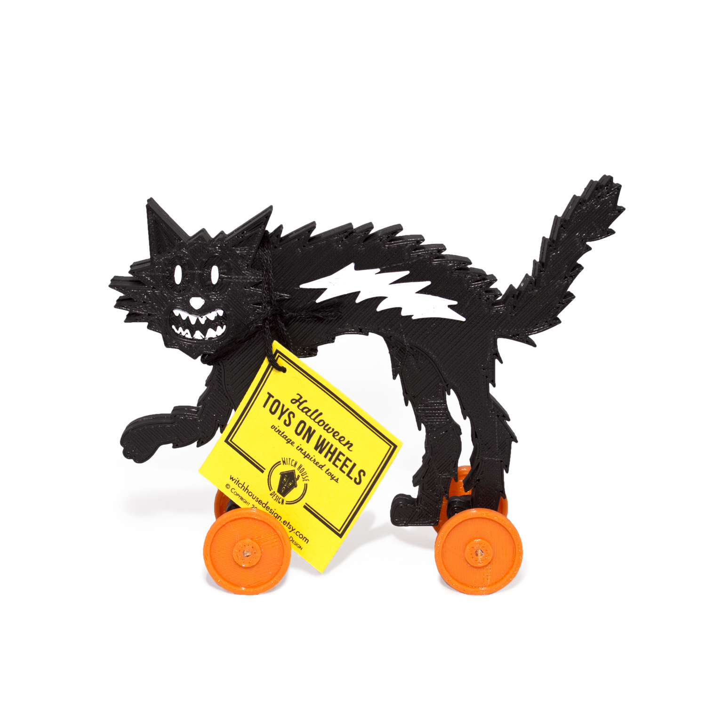 black_cat_w_toys.jpg