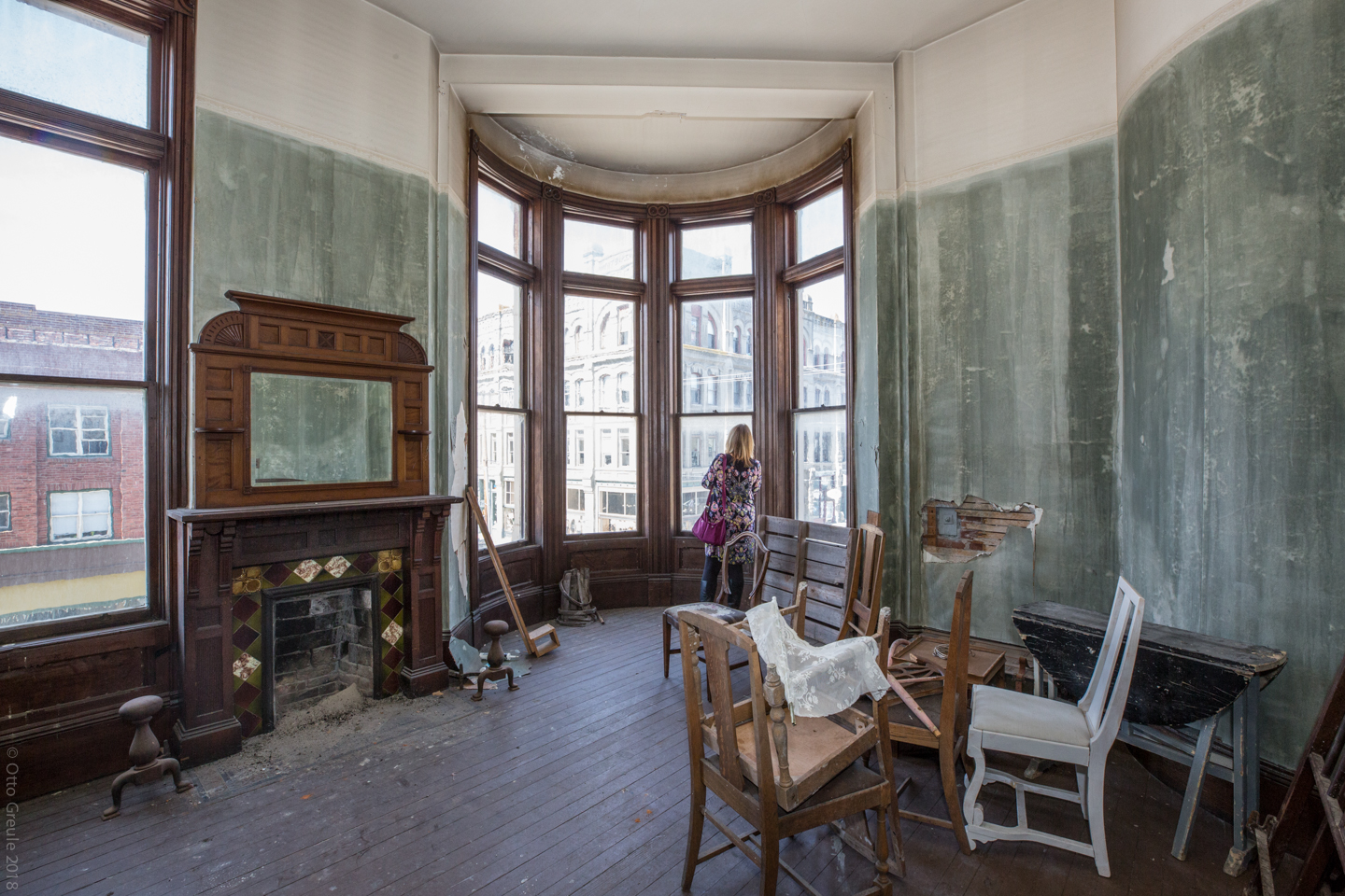 A participant in the RevitalizeWA Historic Preservation conference tours a second floor office space of the Hastings Building. Designed by Elmer H. Fisher, the building was constructed between 1889-90.