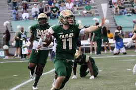 UAB quarterback A.J. Erdely (above, photo, UAB Athletics) and running back Spencer Brown (below, photo, The Daily Dragon) home in on capturing a bowl victory and a tremendous 9 win season for the Blazers