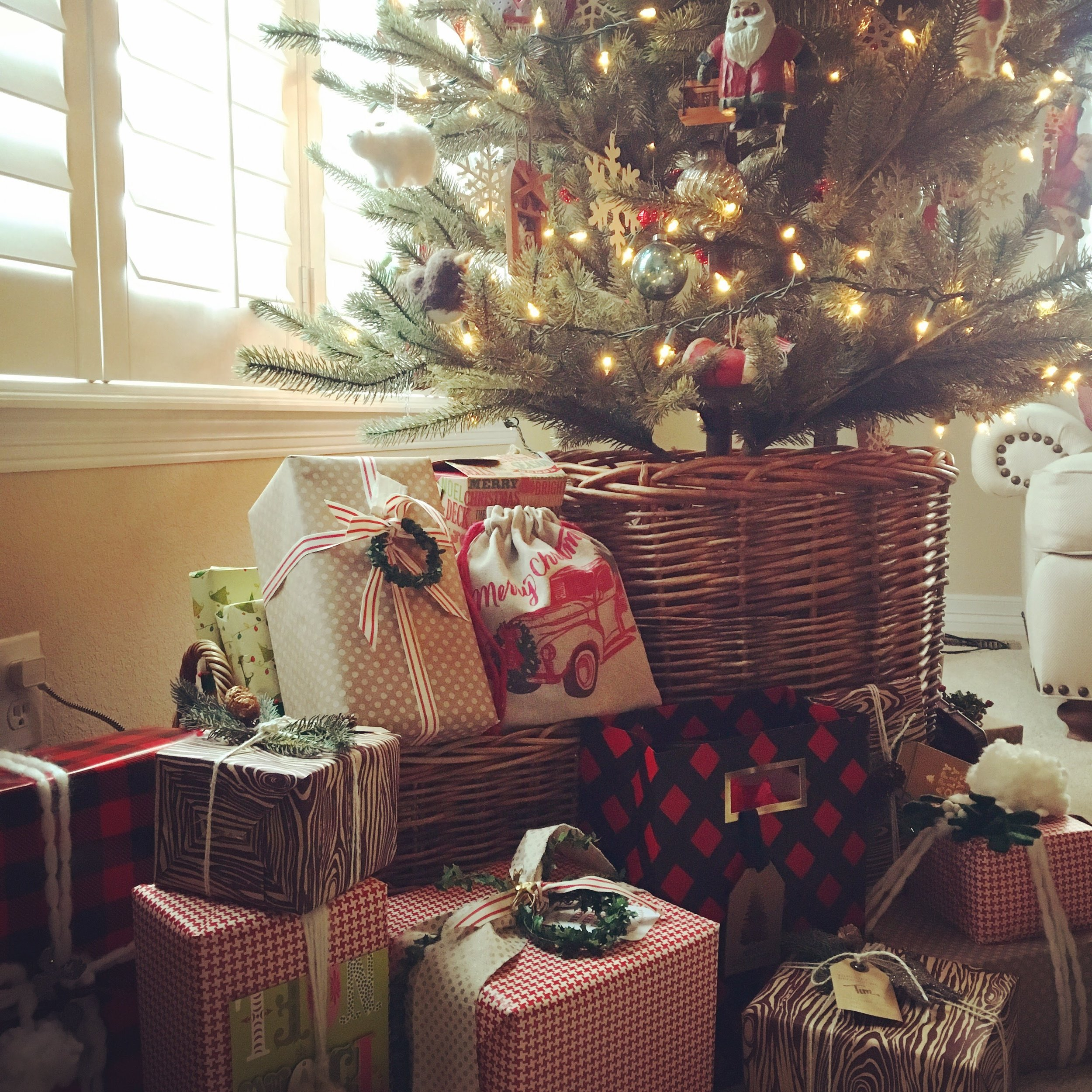 For me the wrapped gifts are part of the decor, I try to get presents in advance so I can get them wrapped and under the tree when we decorate for Christmas just after Thanksgiving.