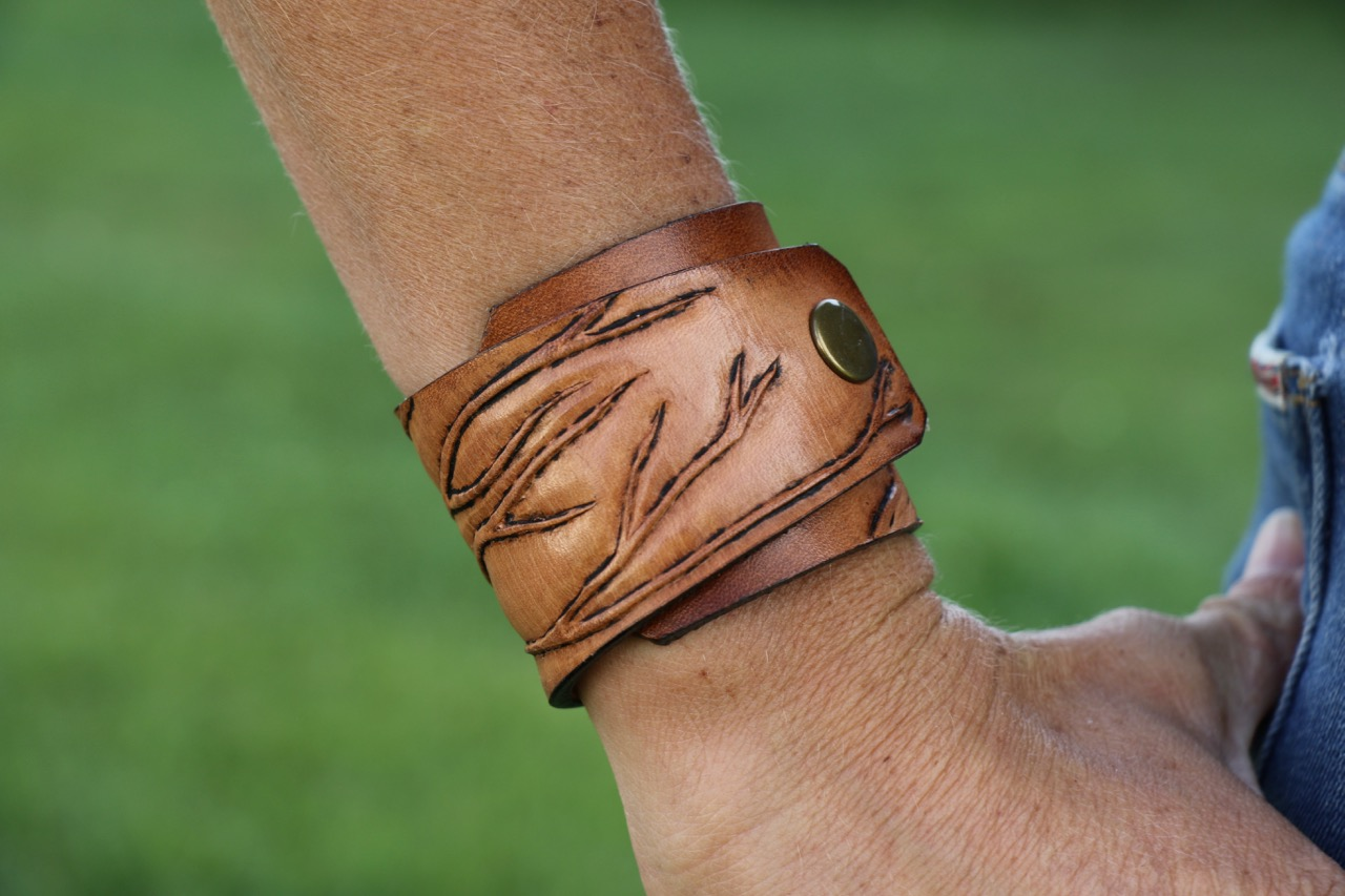 Tooled branches leather cuff