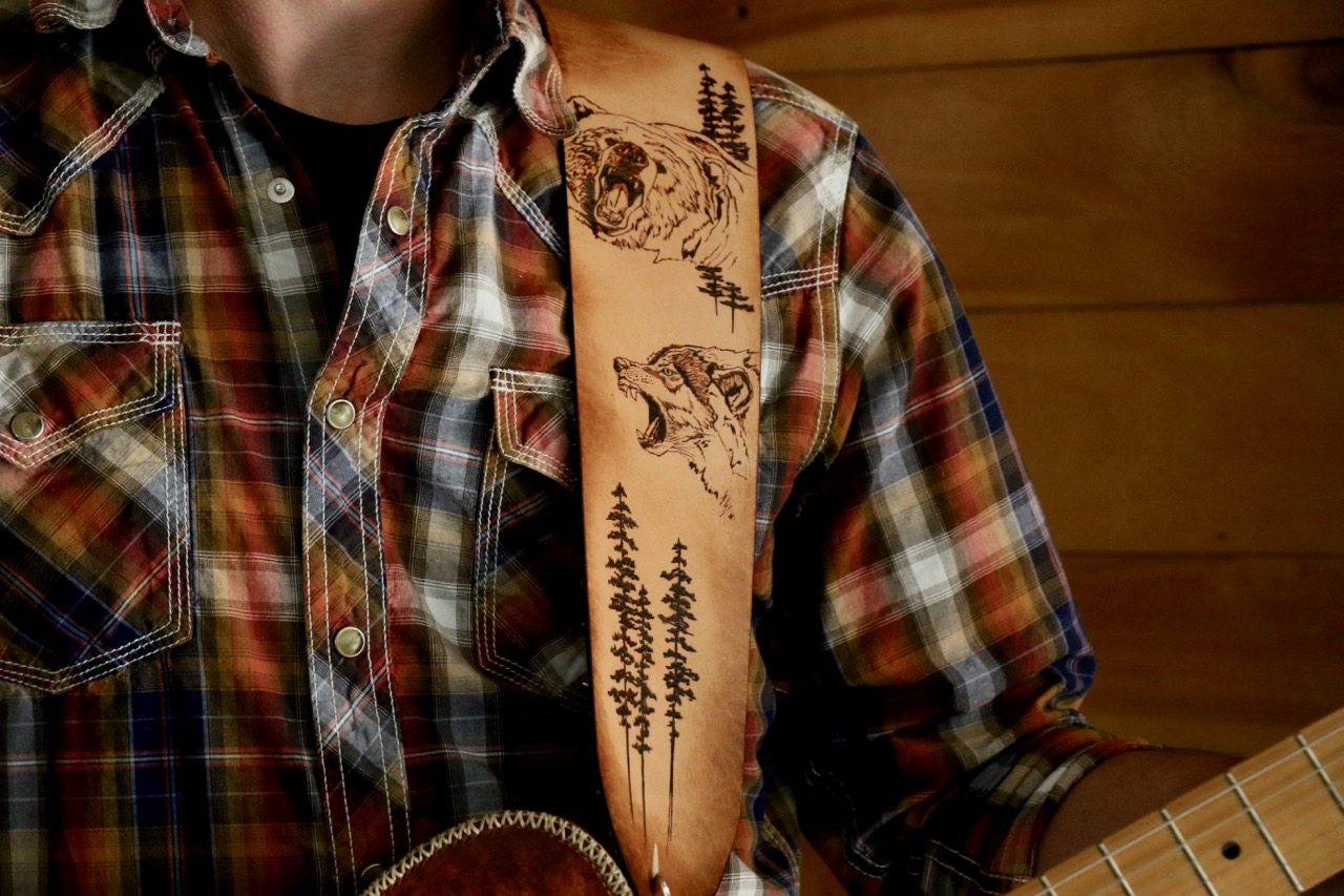 Grizzly and wolf guitar strap