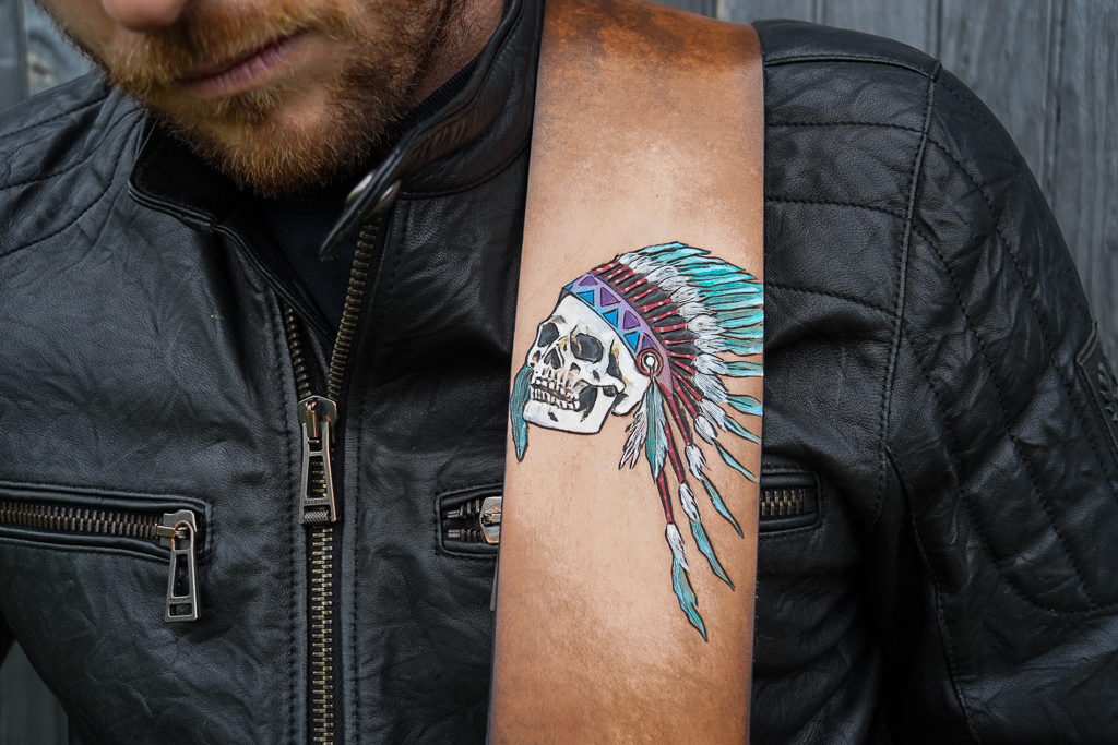 skull wearing head dress guitar strap