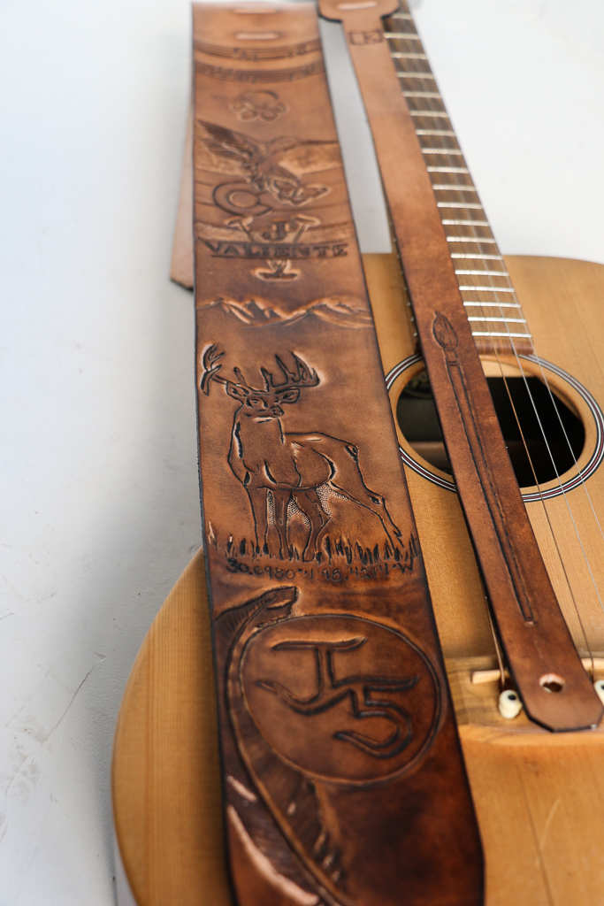 tooled leather guitar strap by Linny Kenney