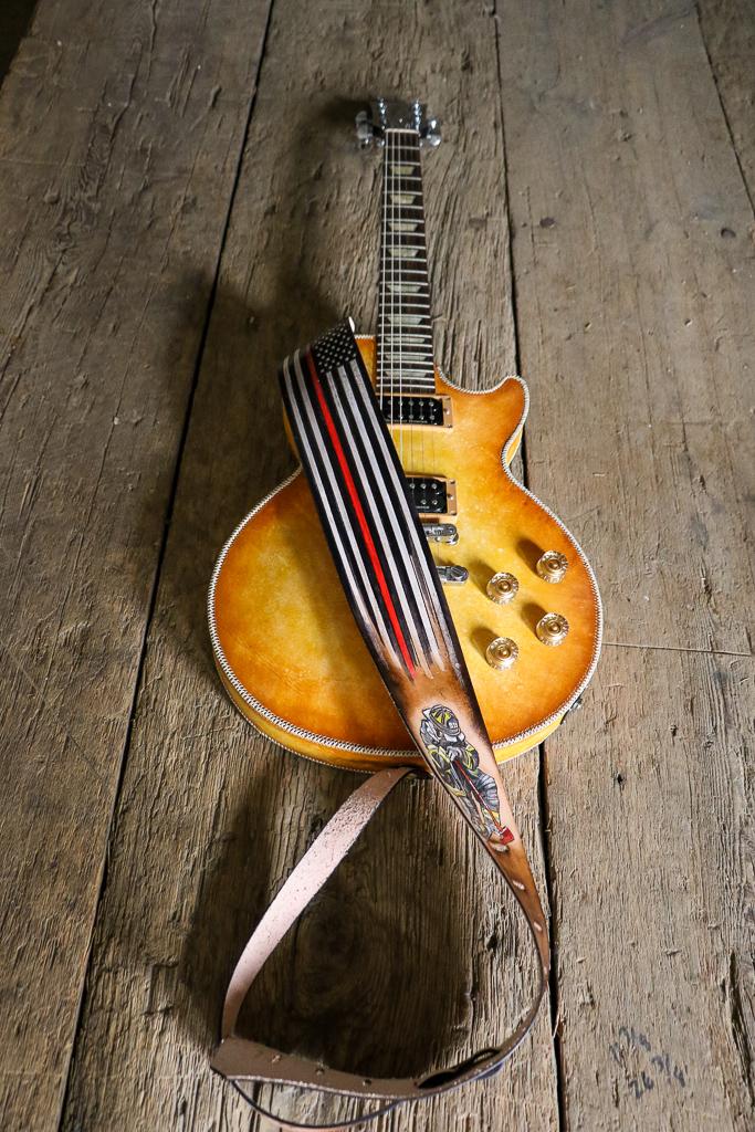 Fallen firefighter guitar strap by Linny Kenney