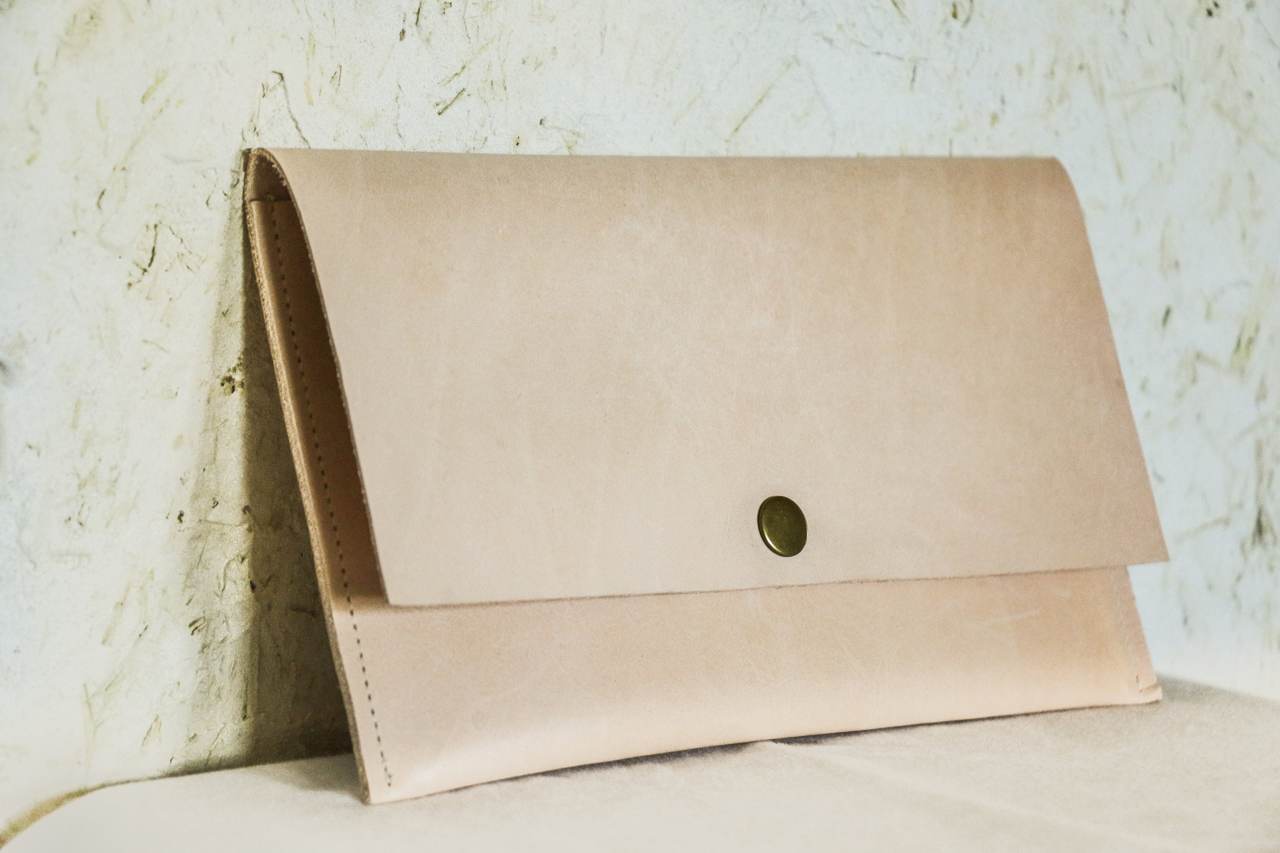 Natural leather clutch by Linny Kenney