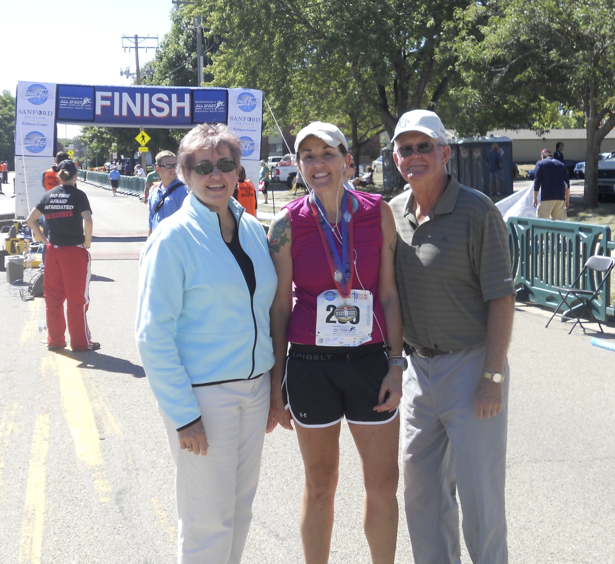 I'm slower than Christmas, but they waited for me at the finish of my first marathon. #biggestfan
