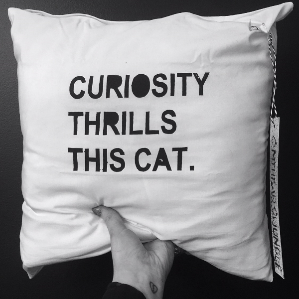 CURIORITY CUSHION LOVER   screen printed on cotton polyester mix.