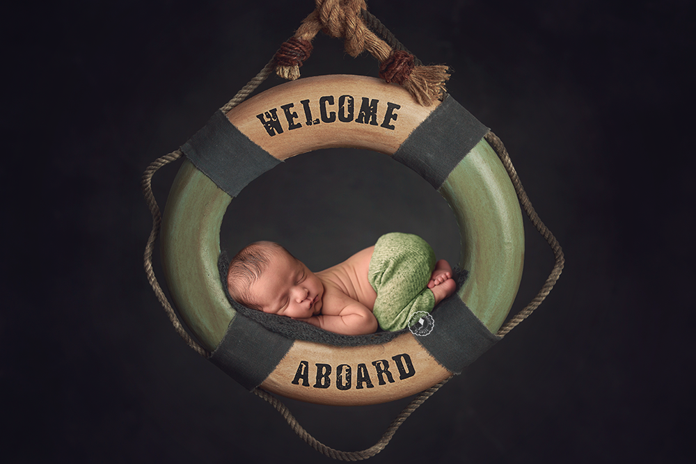 welcome-ring-newborn-session-boca-raton.png
