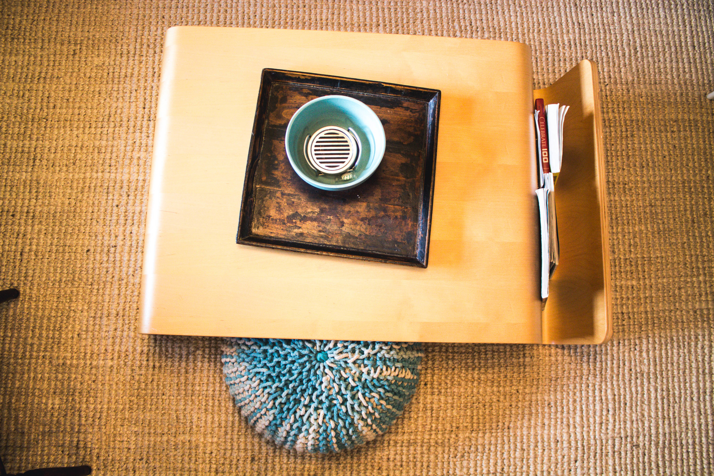 The coffee table is from AllModern and houses magazines and a small pouf for extra seating.