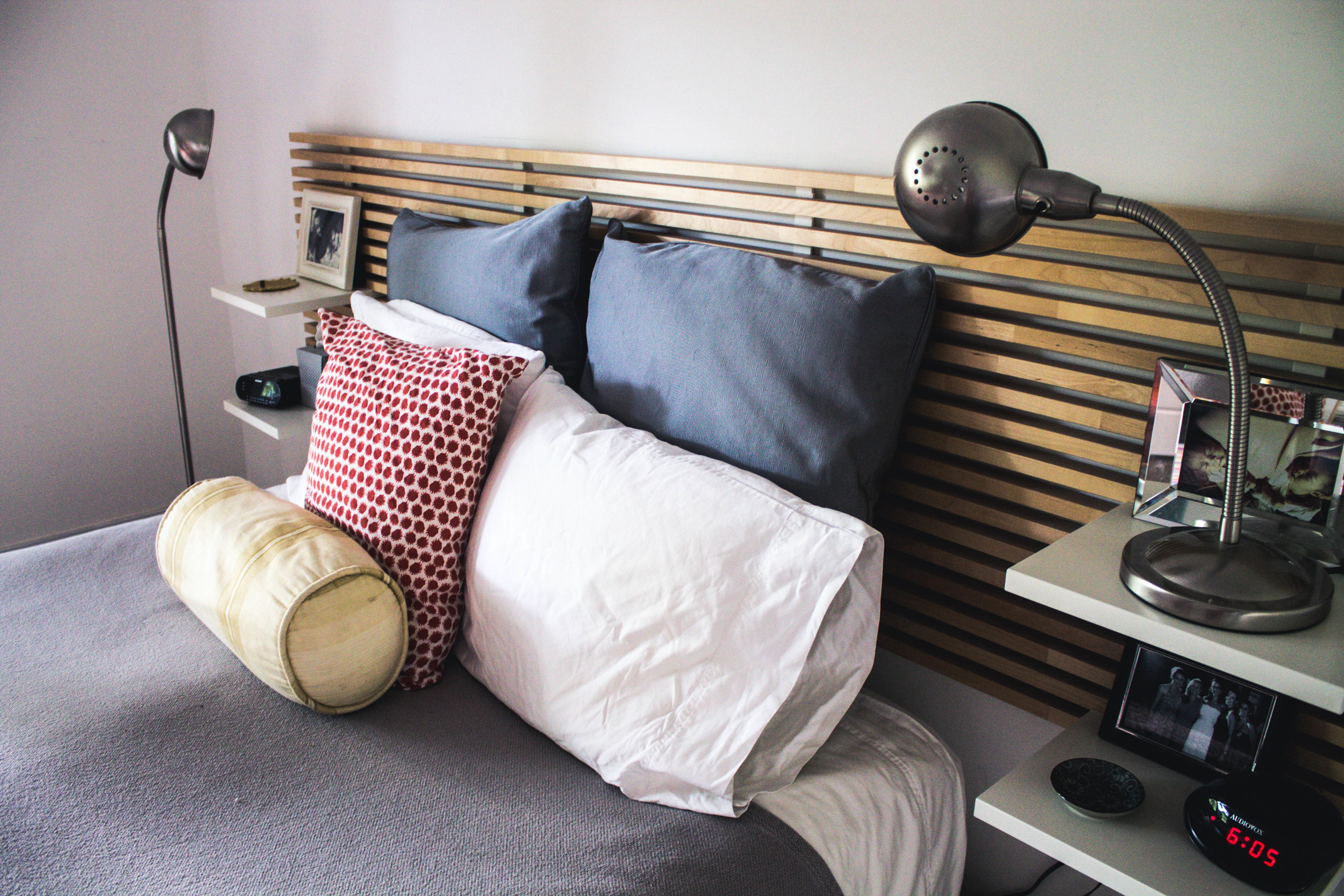 The master bedroom is dominated by an IKEA bed and linens that bring energy and movement while also fostering rest and rejuvenation.
