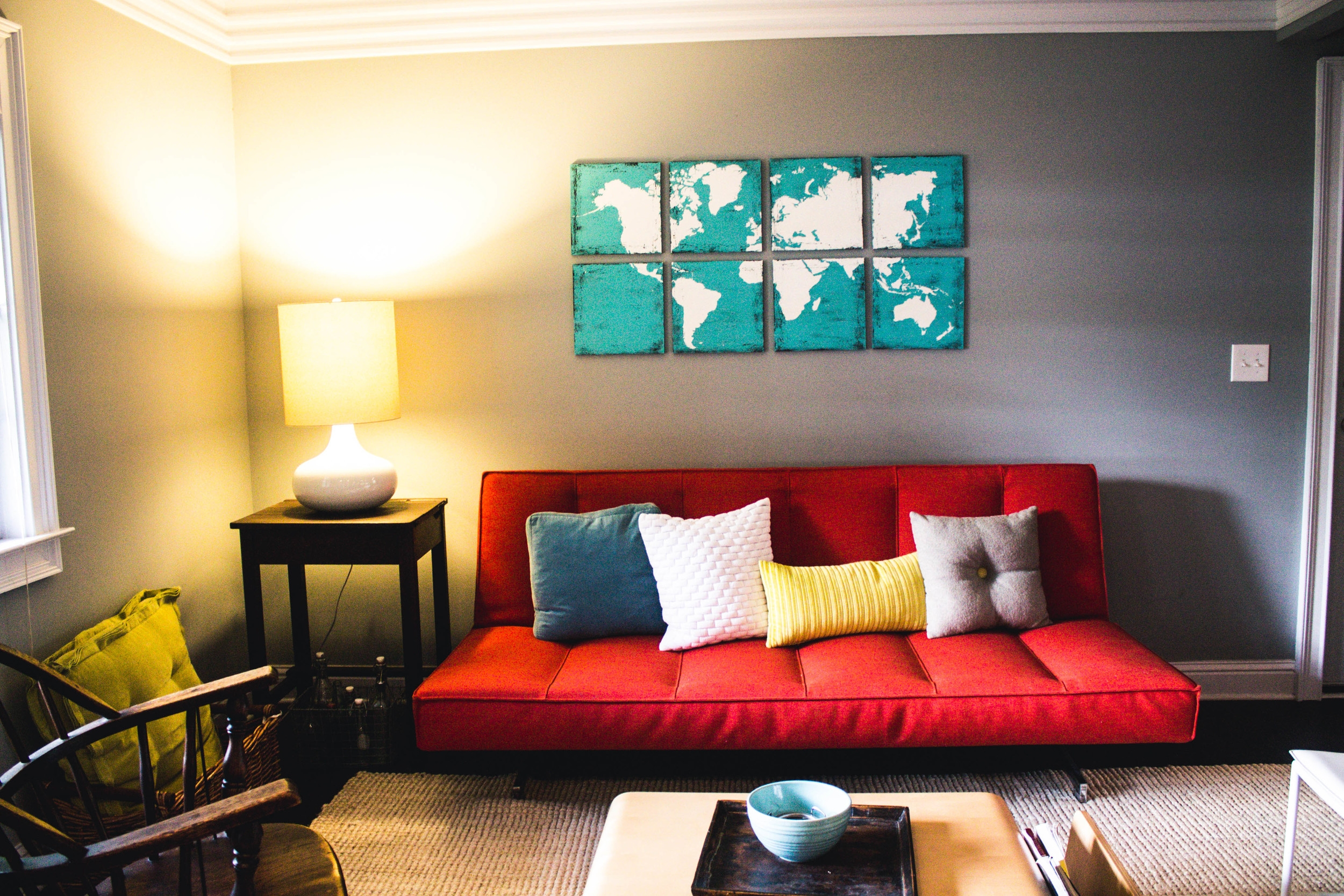 The entry living room is anchored by CB2 and AllModern furniture and capped with artwork found on Etsy.