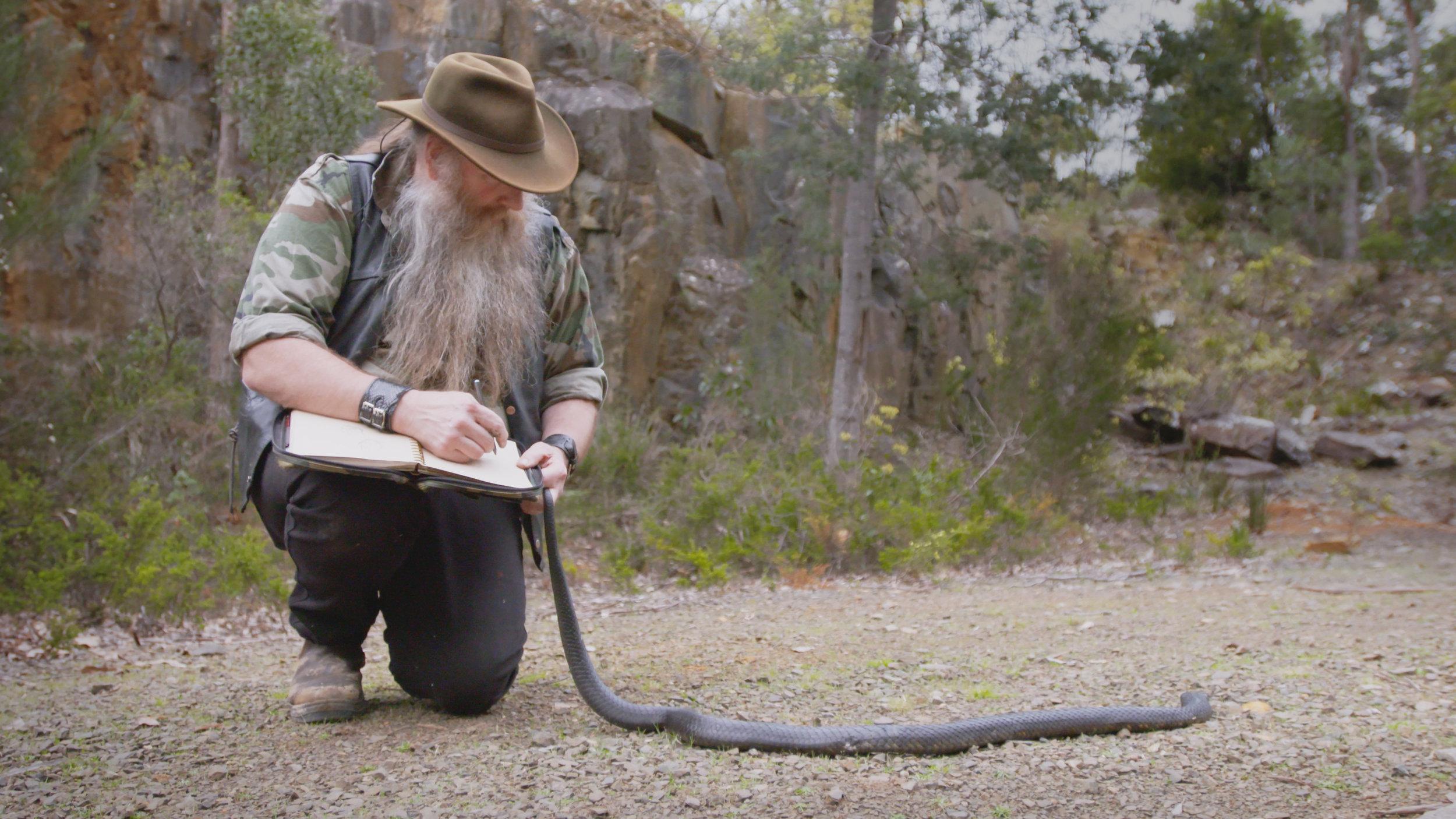 Bill Holding Snake.jpg