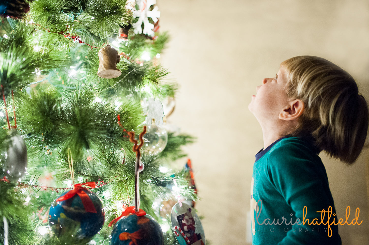 kids by the Christmas tree