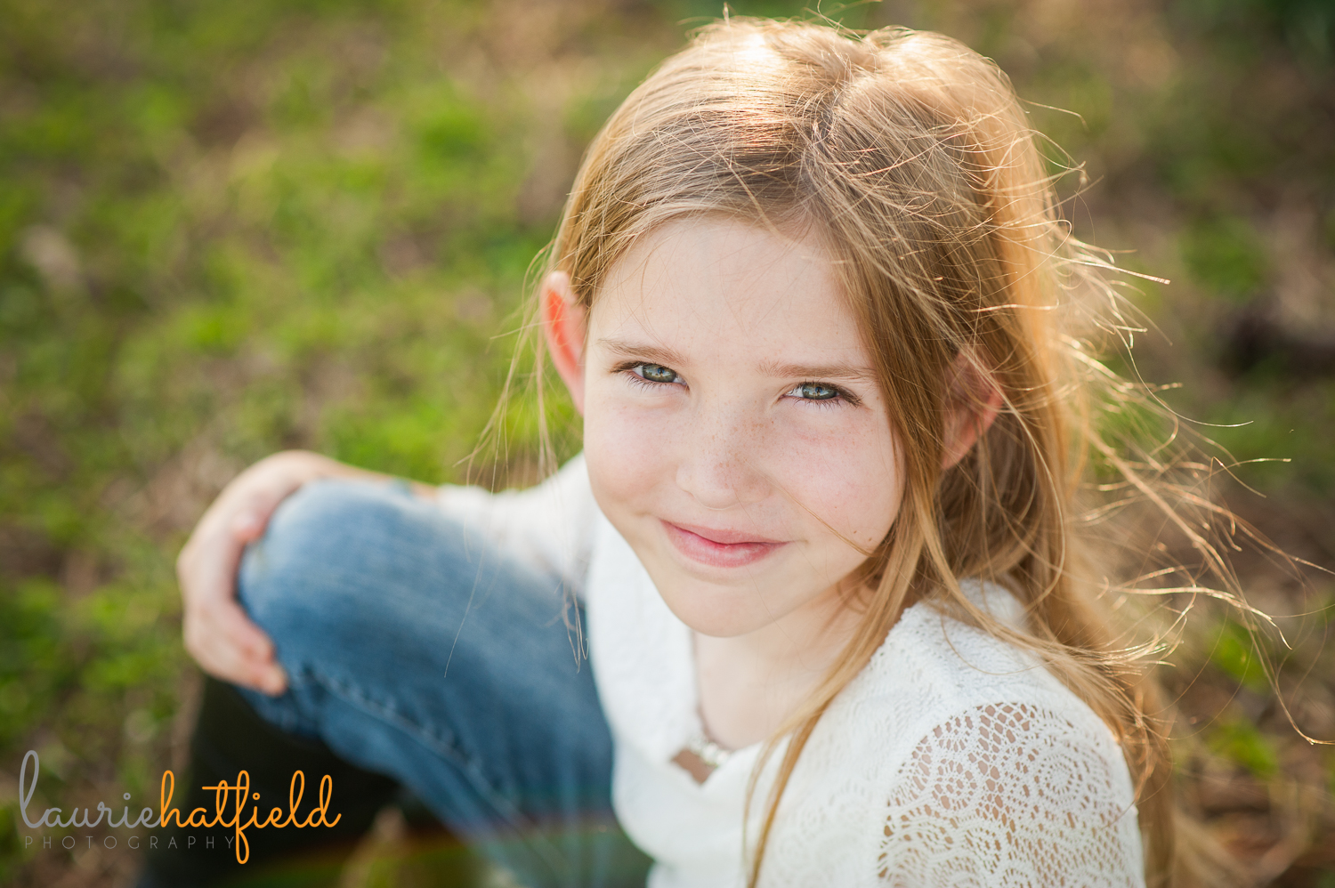 9-year-old girl sitting in grass {madison al photographer}