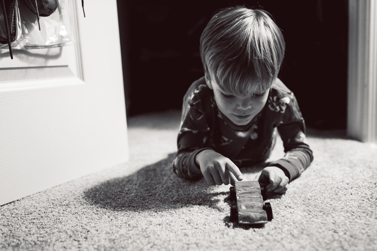 little boy playing with car on carpet | Huntsville photographer