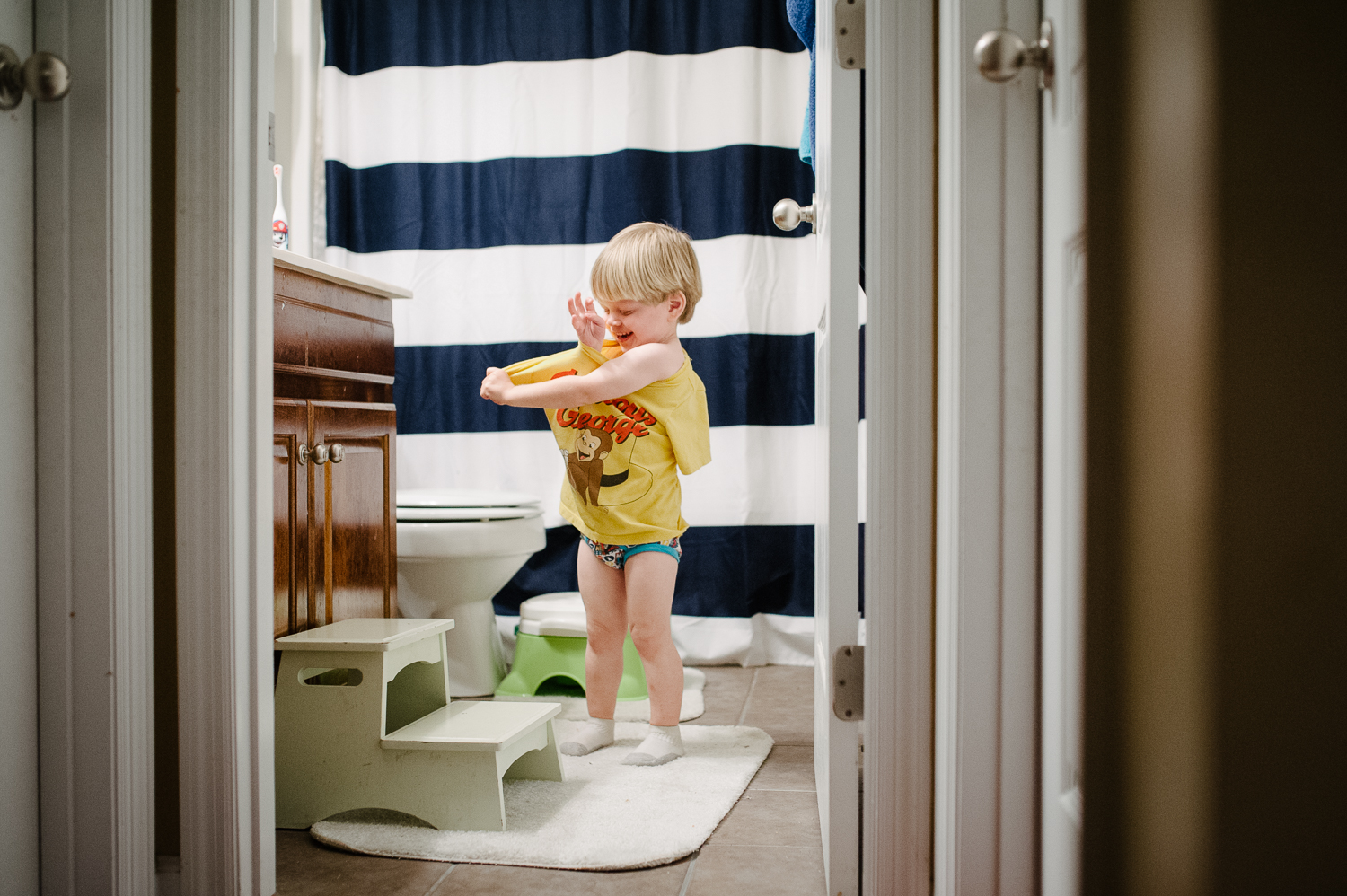 little boy in bathroom taking off shirt | Huntsville photographer