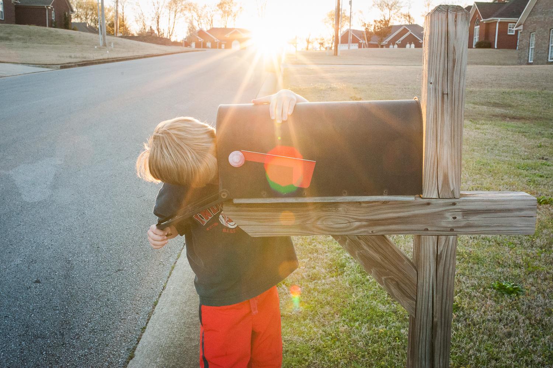 little boy checking mailbox   Huntsville photographer