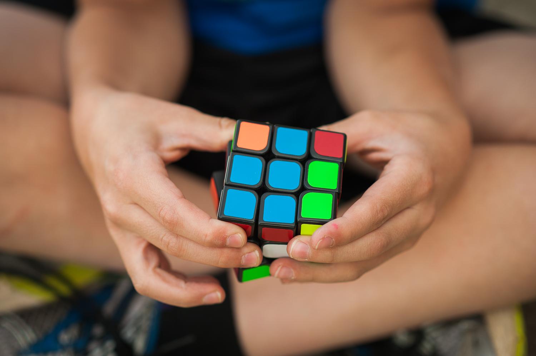 boy holding Rubik's cube   Huntsville family photographer
