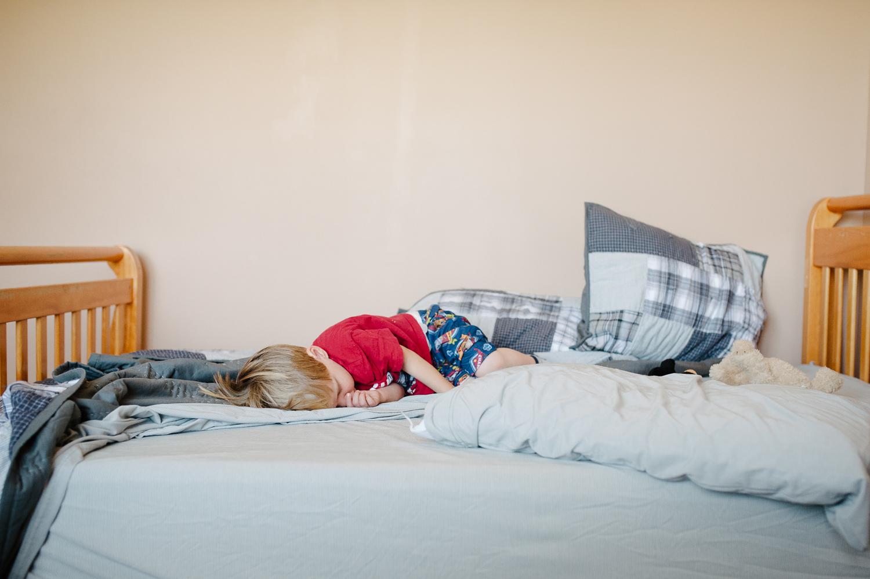 little boy sleeping in big bed   Huntsville photographer