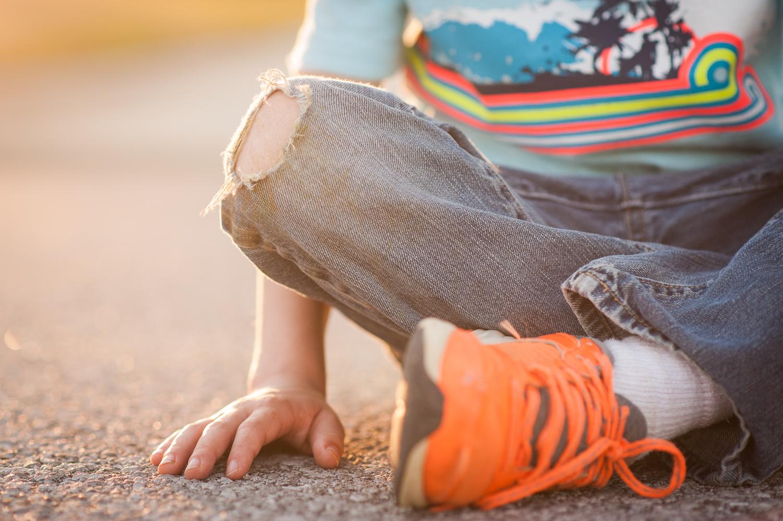 hole in little boy's jeans | Huntsville family photographer