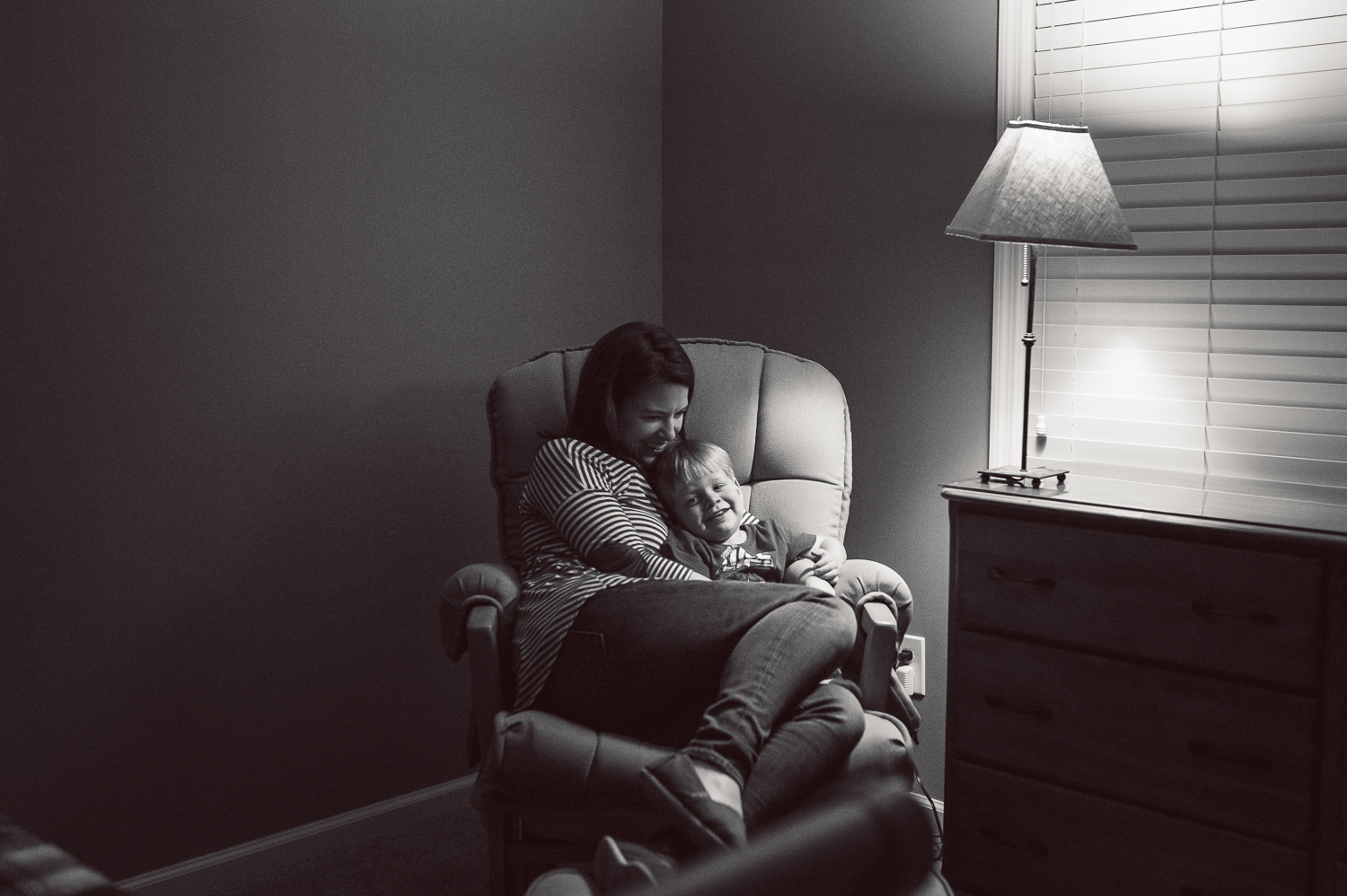 mom and little boy in rocking chair | Huntsville photographer