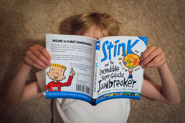 little boy holding Stink book | Huntsville AL photographer