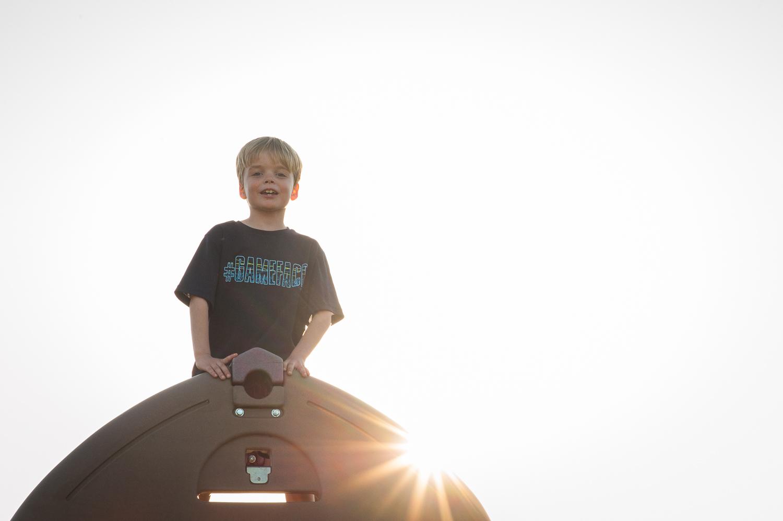 little boy on top of play set | Huntsville family photographer
