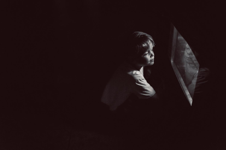 little boy sitting by oven light | Huntsville children's photographer