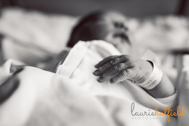baby boy with hospital bracelets   Huntsville newborn photographer