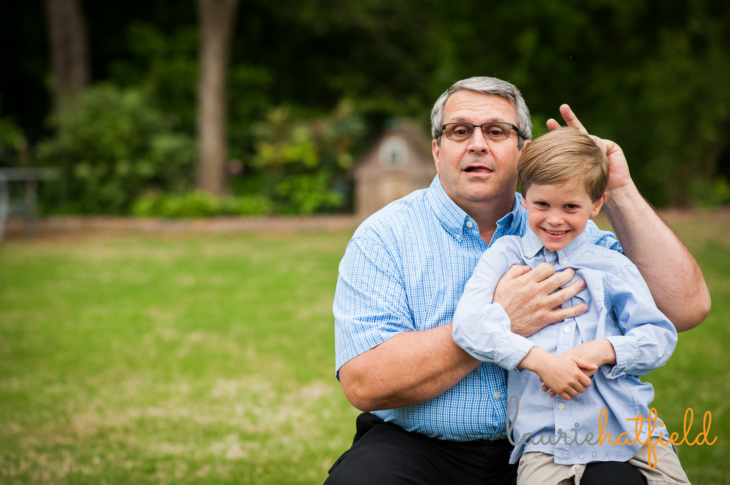 grandfather giving bunny ears to grandson | Huntsville photographer