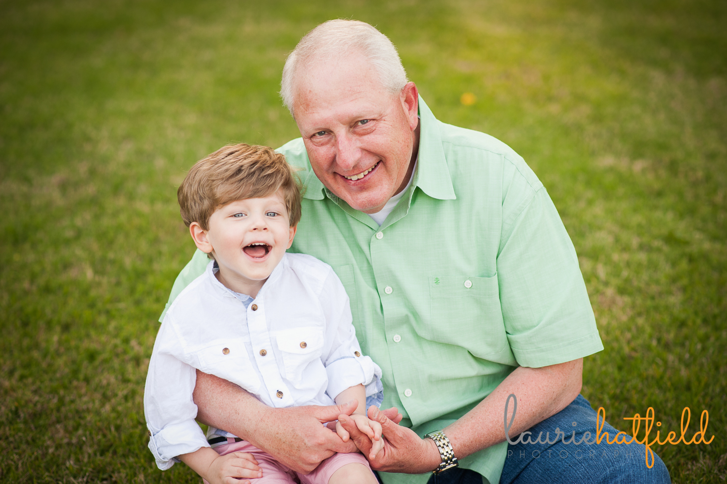 grandfather and 3-year-old grandson laughing | Huntsville photographer