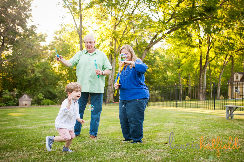 grandparents blowing bubbles with grandson | Huntsville photographer