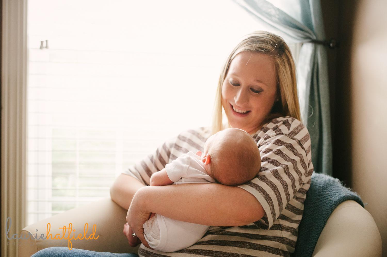 mom sitting and holding new baby | Huntsville AL newborn photos