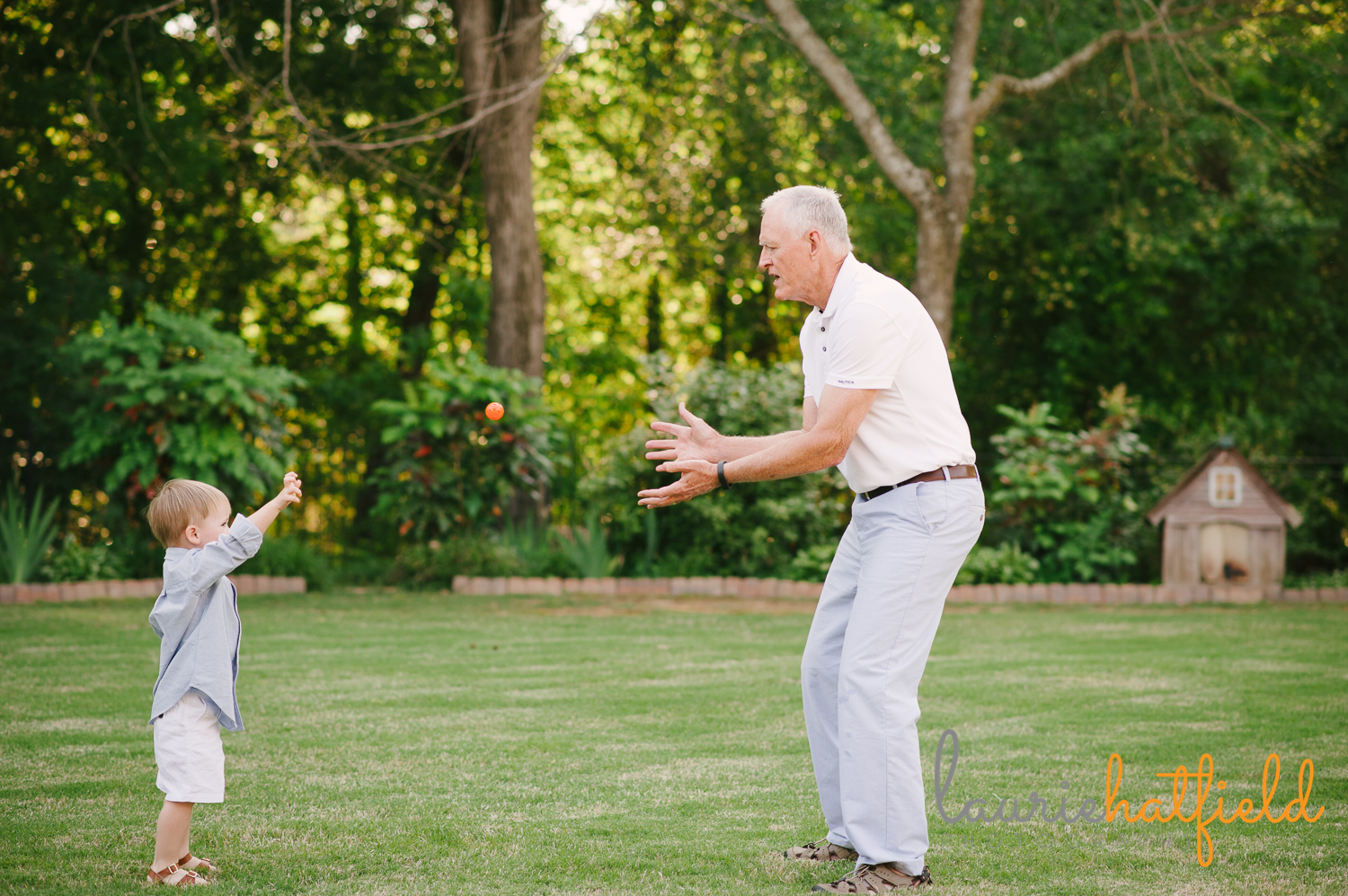grandfather playing catch with 3-year-old grandson | Huntsville family photographer
