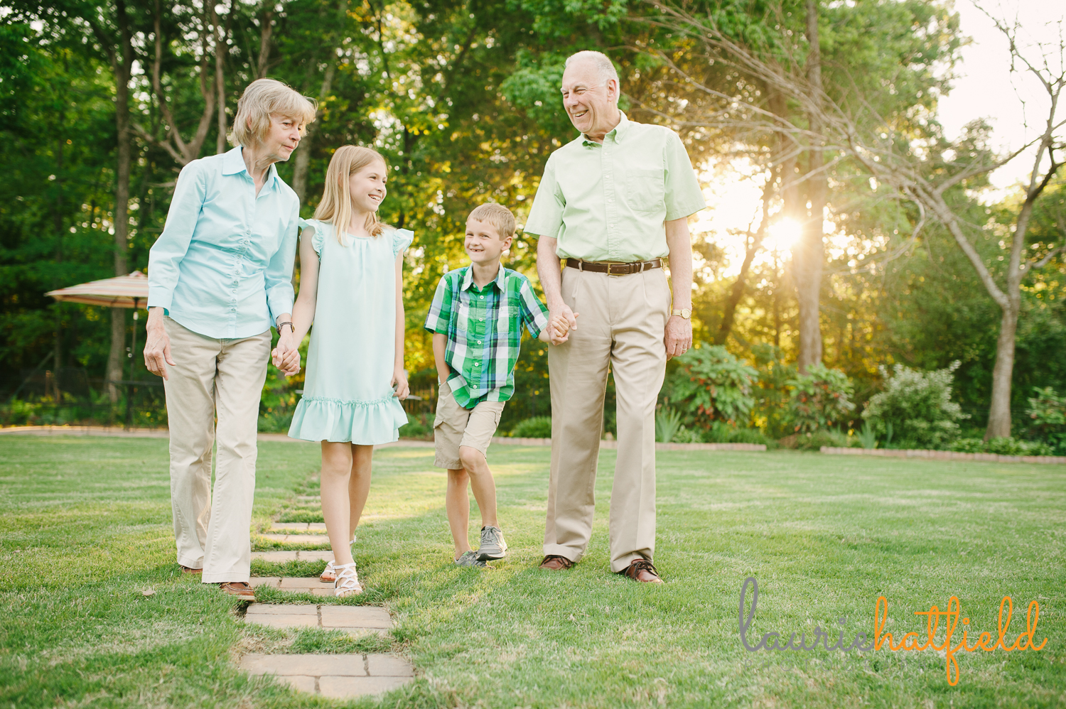 grandparents walking with granddaughter and grandson | Huntsville family photographer