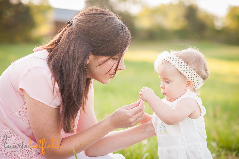 baby girl picking flowers with mom | Huntsville family photographer