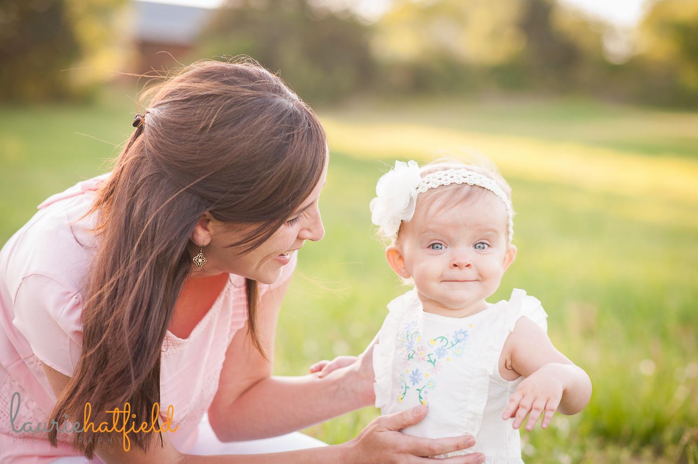 baby girl picking flowers | Huntsville photographer