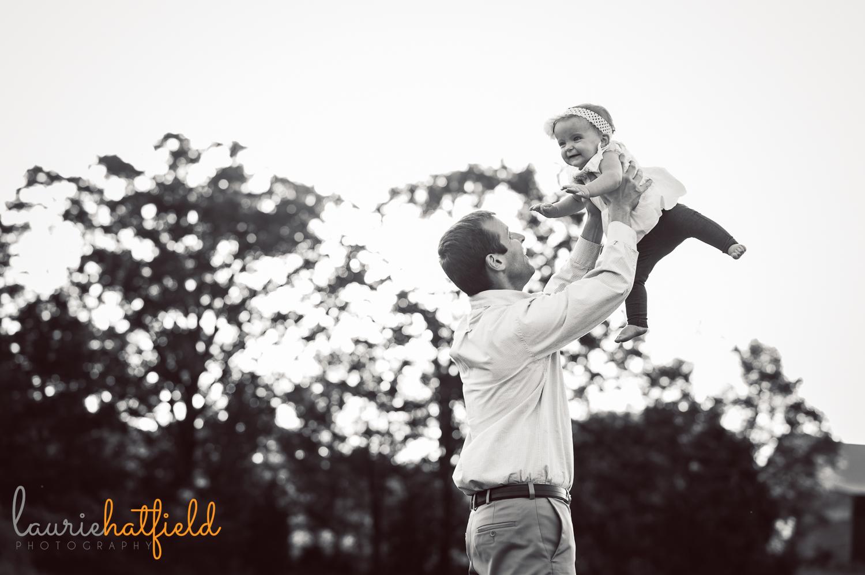 dad tossing baby in air | Huntsville photographer
