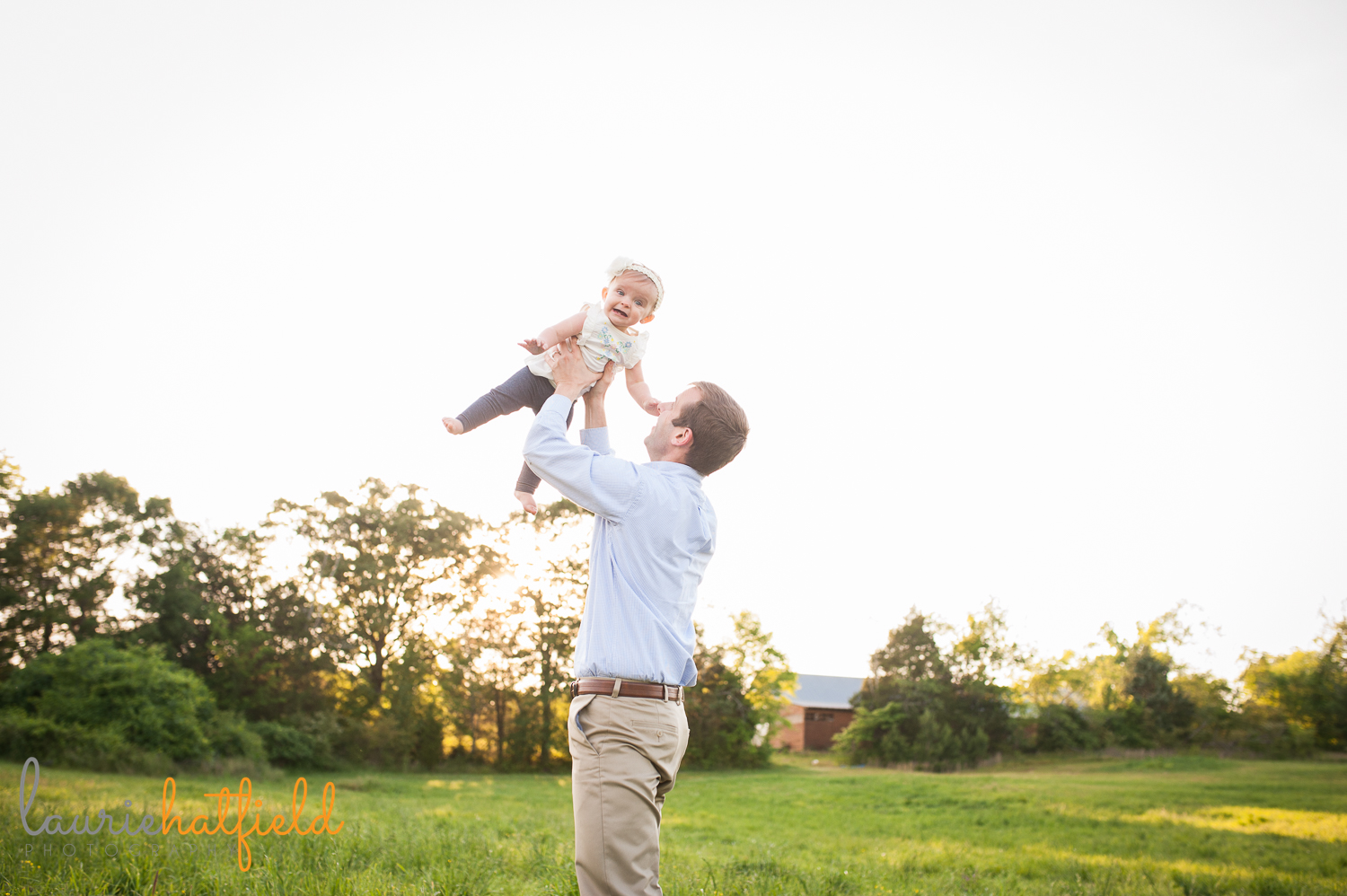 dad tossing baby girl in air | Huntsville family photographer