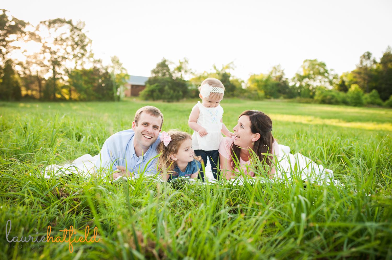 family of four on blanket in grass | Huntsville photographer