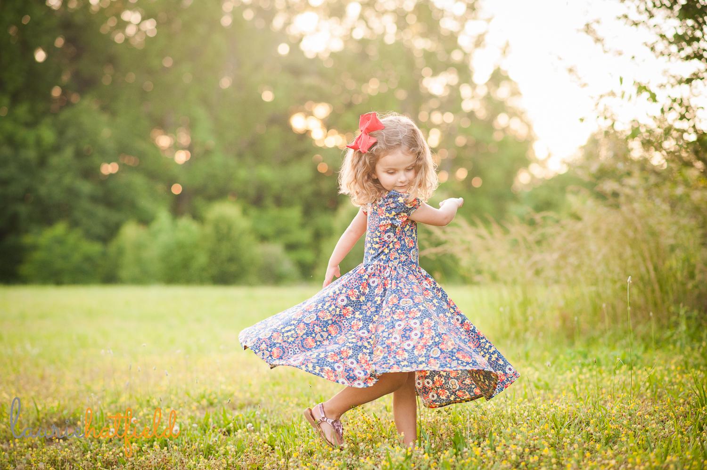 little girl twirling | Huntsville photographer