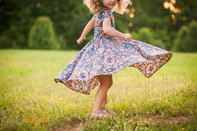 little girl in dress twirling | Huntsville family photographer