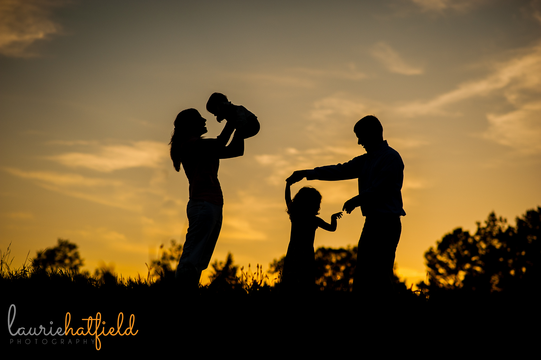 silhouette of family of four | Huntsville photographer